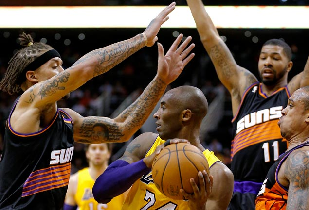 Beasley is to the left. Yes, that bun on top is what propelled the Suns to victory.